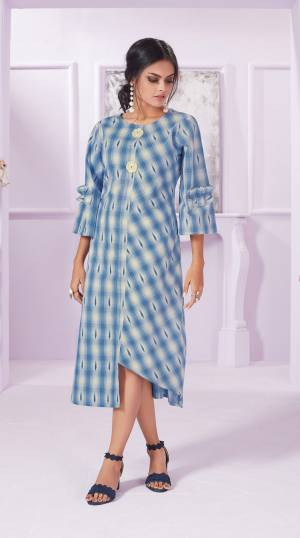 Simple And Elegant Looking Designer Readymade Kurti Is Here In Light Blue Color Fabricated On Cotton. It Is Beautified With Checks Prints All Over With Assymetric Pattern.