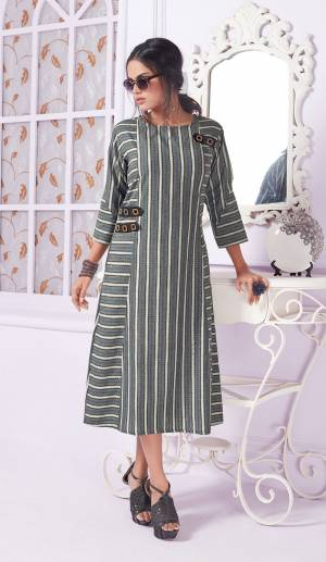 You Will Definitely Earn Lots Of Compliments Wearing This Readymade Formal Pattaerned Kurti In Grey Color. This Kurti Is Cotton Based Beautified With Lining Prints. Buy Now.