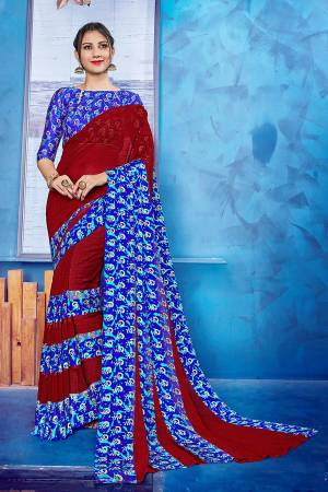Add Some Casulas With This Beautiful Printed Saree Fabricated On Georgette Paireed With Satin Fabricated Blouse. This Saree Is Beautified With Printed Satin Patta Giving It An Attractive Look.