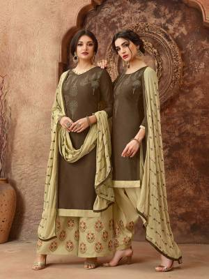 Simple And elegant Looking Straight Suit Is Here In Brown Colored Top Paired With Cream Colored Bottom And Dupatta. This Dress Material Is Cotton Based Paired With Chiffon Fabricated Dupatta. Get This Stitched As A Plazzo Or Salwar As Per Your Desired Comfort.