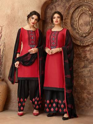 Add This Pretty Dress Material In Red And Black Color For Your Casual Wear, This Dress Material Is Cotton based Paired With Chiffon Fabricated Dupatta. Get This Stitched As Per Your Desired Fit And Comfort. Buy Now.