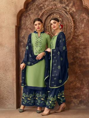 Beat The Heat This Summer With These Cotton Based Dress Material. Grab This Dress Material In Light Green Colored Top Paired With Contrasting Navy Blue Colored Bottom And Dupatta. Its Top And Bottom are Cotton Based Paired With Chiffon Fabricated Dupatta. Buy Now.