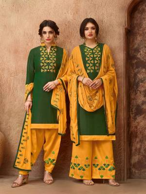 Simple And elegant Looking Straight Suit Is Here In Dark Green Colored Top Paired With Musturd Yellow Colored Bottom And Dupatta. This Dress Material Is Cotton Based Paired With Chiffon Fabricated Dupatta. Get This Stitched As A Plazzo Or Salwar As Per Your Desired Comfort.