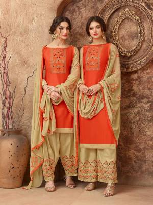 Add This Pretty Dress Material In Orange And Beige Color For Your Casual Wear, This Dress Material Is Cotton based Paired With Chiffon Fabricated Dupatta. Get This Stitched As Per Your Desired Fit And Comfort. Buy Now.