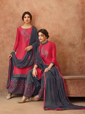 Celebrate This Festive Season With Ease, Comfort And Beauty By Getting This Dress Material Stitched As Per Your Desired Fit And Comfort. Its Top Is In Dark Pink Color Paired With Contrasting Dark Grey Colored Bottom And Dupatta. This Dress Material Is Fabricated On Cotton Paired With Chiffon Dupatta.