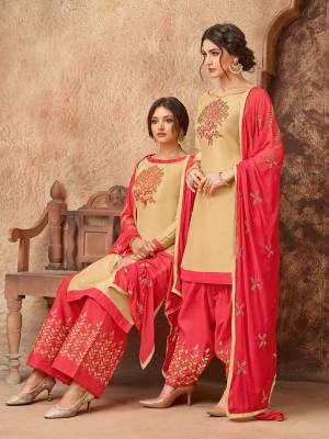 Simple And elegant Looking Straight Suit Is Here In Beige Colored Top Paired With Fuschia Pink Colored Bottom And Dupatta. This Dress Material Is Cotton Based Paired With Chiffon Fabricated Dupatta. Get This Stitched As A Plazzo Or Salwar As Per Your Desired Comfort.