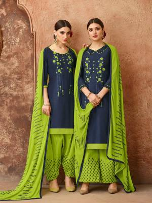 Add This Pretty Dress Material In Navy Blue And Parrot Green Color For Your Casual Wear, This Dress Material Is Cotton based Paired With Chiffon Fabricated Dupatta. Get This Stitched As Per Your Desired Fit And Comfort. Buy Now.