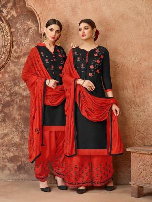 Celebrate This Festive Season With Ease, Comfort And Beauty By Getting This Dress Material Stitched As Per Your Desired Fit And Comfort. Its Top Is In Black Color Paired With Contrasting Red Colored Bottom And Dupatta. This Dress Material Is Fabricated On Cotton Paired With Chiffon Dupatta.