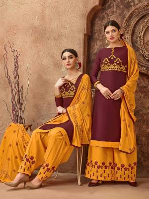 Beat The Heat This Summer With These Cotton Based Dress Material. Grab This Dress Material In Maroon Colored Top Paired With Contrasting Musturd Yellow Colored Bottom And Dupatta. Its Top And Bottom are Cotton Based Paired With Chiffon Fabricated Dupatta. Buy Now.