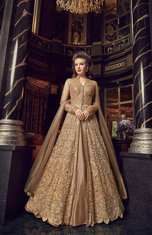 Flaunt Your Rich And Elegant Taste In This Designer Indo-Western Suit In Beige Color. Its Top And Dupatta Are Net Based With Heavy Embroidery, Available With A Lehenga And Embroidered Pants. Its Lehenga And Pants Are Fabricated On Art Silk. You Can Pair With Any Of Them As Per The Occasion.
