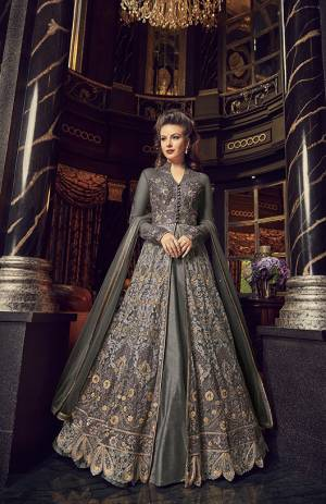 Flaunt Your Rich And Elegant Taste In This Designer Indo-Western Suit In Dark Grey Color. Its Top And Dupatta Are Net Based With Heavy Embroidery, Available With A Lehenga And Embroidered Pants. Its Lehenga And Pants Are Fabricated On Art Silk. You Can Pair With Any Of Them As Per The Occasion.