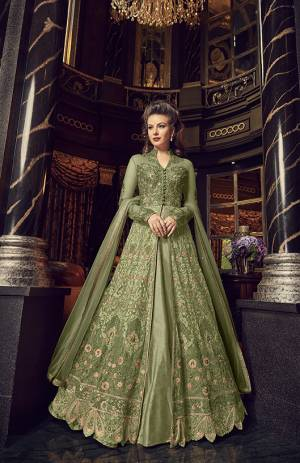 Flaunt Your Rich And Elegant Taste In This Designer Indo-Western Suit In Light Green Color. Its Top And Dupatta Are Net Based With Heavy Embroidery, Available With A Lehenga And Embroidered Pants. Its Lehenga And Pants Are Fabricated On Art Silk. You Can Pair With Any Of Them As Per The Occasion.