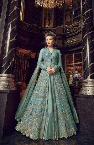 Flaunt Your Rich And Elegant Taste In This Designer Indo-Western Suit In Turquoise Blue Color. Its Top And Dupatta Are Net Based With Heavy Embroidery, Available With A Lehenga And Embroidered Pants. Its Lehenga And Pants Are Fabricated On Art Silk. You Can Pair With Any Of Them As Per The Occasion.