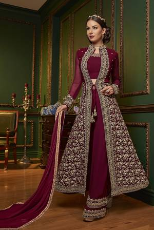 New Patterned Designer Indo-Western Dress Is Here In Maroon Color. It Has Heavy Embroidered Top And Plazzo Pants Fabricated On Georgette Paired With Chiffon Dupatta. This Pretty Designer Dress Will Definitely Earn You Lots Of Compliments From Onlookers.