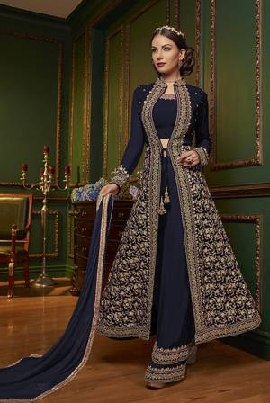New Patterned Designer Indo-Western Dress Is Here In Navy Blue Color. It Has Heavy Embroidered Top And Plazzo Pants Fabricated On Georgette Paired With Chiffon Dupatta. This Pretty Designer Dress Will Definitely Earn You Lots Of Compliments From Onlookers.