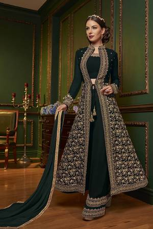 New Patterned Designer Indo-Western Dress Is Here In Dark Green Color. It Has Heavy Embroidered Top And Plazzo Pants Fabricated On Georgette Paired With Chiffon Dupatta. This Pretty Designer Dress Will Definitely Earn You Lots Of Compliments From Onlookers.