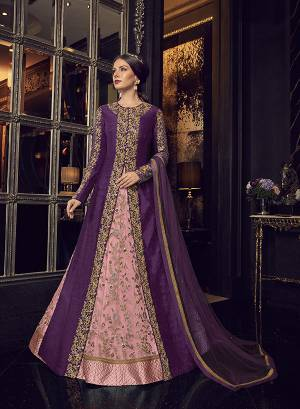 Add This Elegant And New Patterned Indo-Western Dress To Your Wardrobe In Shades Of Pink. It Has Very Pretty Pink Colored Gown With A Purple Colored Jacket Paired With Pink Colored Embroidered Pants And Purple Dupatta. Its Heavy Embroidered Gown Is Net Based Paired With Art Silk Jacket , Art Silk Pant And Net Fabricated Dupatta.