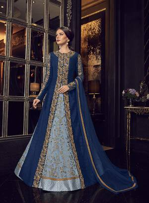 Add This Elegant And New Patterned Indo-Western Dress To Your Wardrobe In Shades Of Blue. It Has Very Pretty Steel Blue Colored Gown With A Royal Blue Colored Jacket Paired With Steel Blue Colored Embroidered Pants And Royal Blue Dupatta. Its Heavy Embroidered Gown Is Net Based Paired With Art Silk Jacket , Art Silk Pant And Net Fabricated Dupatta.