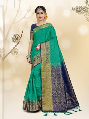 Here Is A Very Beautiful Silk Based Saree Isea Gren Color Paired With Navy Blue Colored Blouse. This Saree And Blouse Are Fabricated On Embossed Jacquard Beautified With Weave All Over.