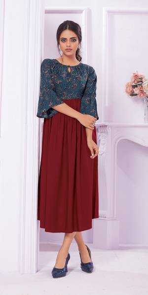 Grab This Pretty Readymade Kurti For Your Semi-Casual Wear In Maroon And Blue Color Fabricated On Rayon Beautified With Prints Over The Yoke.