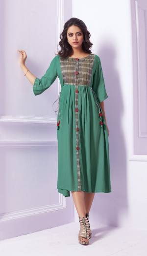 Here Is A Pretty Shade In Green With This Readymade Designer Kurti In Sea Green Color Fabricated On Rayon. It Is Soft Towards Skin And Easy To Carry All Day Long.