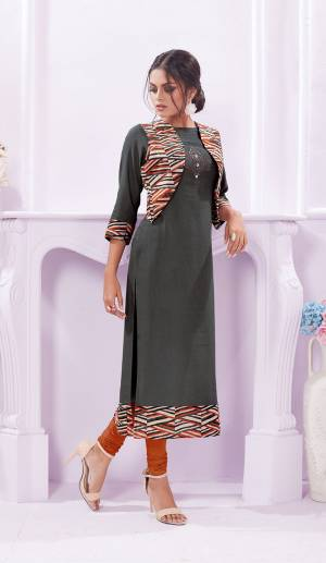Rich And Elegant Looking Designer Readymade Kurti Is Here In Grey Color Fabricated On Rayon Paired With Printed Jacket.
