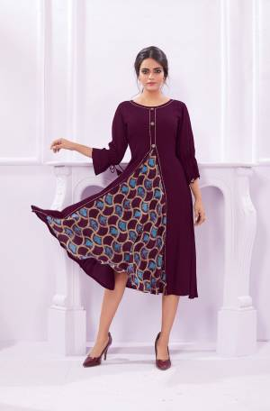 Add This New Shade To Your Wardrobe With This Designer Readymade Kurti In Wine Color Fabricated On Rayon. This Kurti Is Light Weight And Easy To Carry All Day Long.