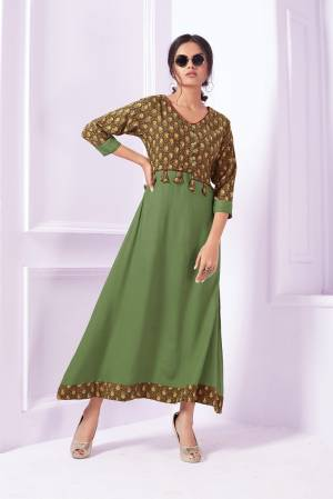 Long Designer Readymade Kurti Is Here In Green Color With Yoke Pattern. It Is Fabricated On Rayon Beautified With Prints.