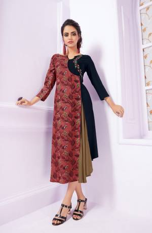 New And Unique Patterned Designer Readymade Kurti Is Here In Pink And Navy Blue Color Fabricated On Rayon. It Is Beautified With Prints Ans Its Fabrics Ensures Superb Comfort all Day Long.