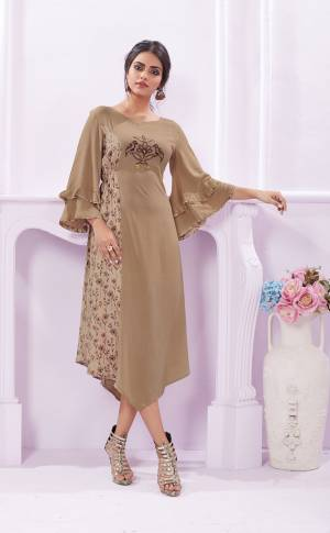 Flaunt Your Rich And Elegant Taste Wearing This Designer Readymade Kurti In Beige Color Fabricated On Rayon. Its Elegant Color And Soft Fabric Makes This Kurti A Perfect Piece.