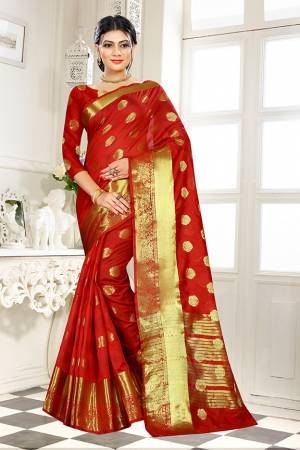Add This Beautiful Silk Based Saree To Your Wardrobe In Red Color Paired With Red Colored Blouse. It Is Beautified With Attractive Butti Weave Over The Saree And Blouse. Buy Now.