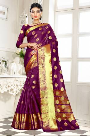 Beat This Heat This Summer Wearing This Pretty Attractive Wine Colored Saree. This Saree And Blouse Are Fabricated On Banarasi Art Silk Beautified With Weave Butti All Over. Also It Is Light In Weight And Easy To Carry All Day Long