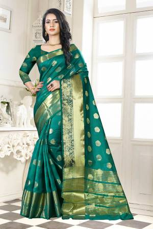 Beat This Heat This Summer Wearing This Pretty Attractive Teal Green Colored Saree. This Saree And Blouse Are Fabricated On Banarasi Art Silk Beautified With Weave Butti All Over. Also It Is Light In Weight And Easy To Carry All Day Long