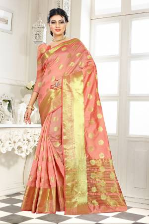 Add This Beautiful Silk Based Saree To Your Wardrobe In Peach Color Paired With Peach Colored Blouse. It Is Beautified With Attractive Butti Weave Over The Saree And Blouse. Buy Now.
