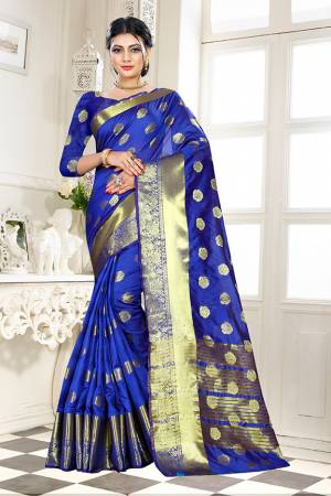 Beat This Heat This Summer Wearing This Pretty Attractive Royal Blue Colored Saree. This Saree And Blouse Are Fabricated On Banarasi Art Silk Beautified With Weave Butti All Over. Also It Is Light In Weight And Easy To Carry All Day Long