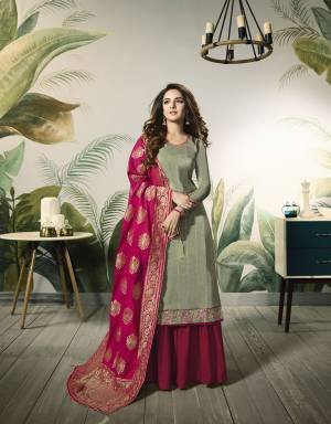Grab This Beautful Designer Plazzo Suit In Pastel Green Colored Top Paired With Contrasting Rani Pink Colored Bottom And Dupatta,Its Top Is Fabricated On Satin Silk Paired With Santoon Bottom And Banarasi Jacquard Silk Dupatta.