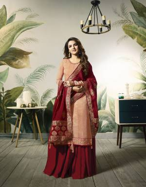 A Must Have Shade In Every Womens Wardrobe Is Here With This Designer Straight Plazzo Suit In Peach Colored Top Paired With Contrasting Maroon Colored Bottom And Dupatta. Its Pretty Embroidred Top Is Fabricated On Satin Silk Paired With Santoon Bottom And Banarasi Silk Fabricated Dupatta.