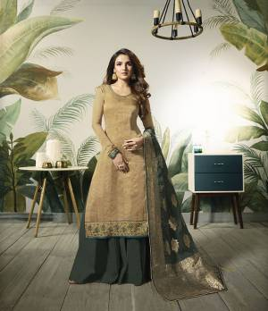 Celebrate This Festive Season Wearing This Designer Straight Suit In Beige Colored Top Paired With Contrasting Dark Green Colored Bottom And Dupatta. Its Top Is Fabricated On Satin Silk Paired With Santoon Bottom And Banarasi Silk Dupatta.