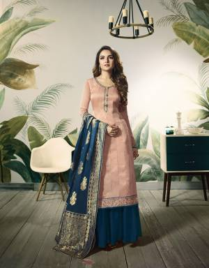 Look Pretty In This Designer Plazzo Suit In Baby Pink Colored Top Paired With Contrasting Blue Colored Bottom And Dupatta. Its Top Is Fabricated On Satin Silk Paired With Santoon Bottom And Banarasi Silk Fabricated Dupatta. All Its Fabrics Ensures Superb Comfort Throughout The Gala.