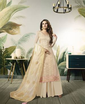 Flaunt Your Rich And Elegant Taste Wearing This Designer Straight Cut Plazzo Suit In Cream Color. Its Top Is Fabricated On Satin Silk Paired With Santoon Bottom Amd Banarasi Silk Fabricated Dupatta.