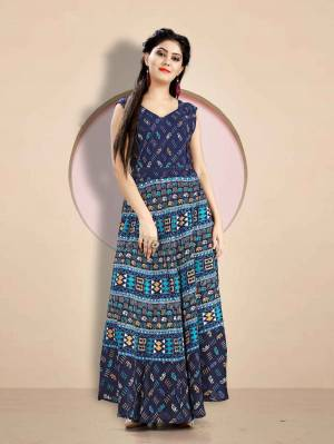 Here Is A Very Pretty Long Kurti For These Summer In Navy Blue Color Fabricated Rayon. It Is Beautified With Prints All Over. Buy Now.