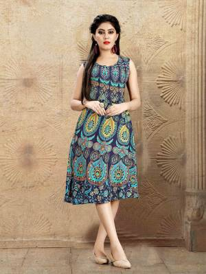 Beat The Heat Wearing This Knee Length Readymade Kurti In Blue Color. This Kurti Is Fabricated On Rayon Beautified With Prints All Over.