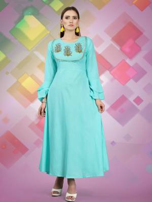 For Your Semi Casuals, Grab This Designer Readymade Kurti In Sky Blue Color Fabricated On Rayon, It Has Attractive Yoke With Prints And Lace Border. Buy Now.