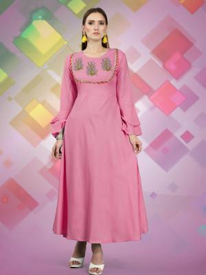 For Your Semi Casuals, Grab This Designer Readymade Kurti In Pink Color Fabricated On Rayon, It Has Attractive Yoke With Prints And Lace Border. Buy Now.