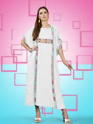 Beautiful Jacket Patterned Designer Readymade Kurti Is Here In White Color Fabricated On Rayon. It Has Pretty Thread Work Over The Yoke Making This Kurti More Attractive, Buy Now.
