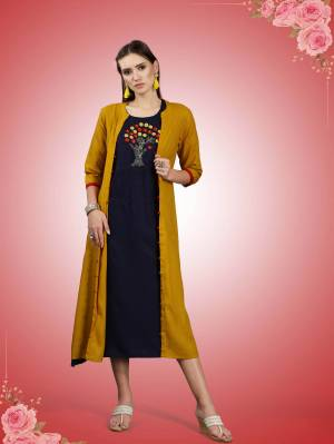 Beautiful Jacket Patterned Designer Readymade Kurti Is Here In Musturd Yellow And Navy Blue Color Fabricated On Rayon. It Has Pretty Thread Work Over The Yoke Making This Kurti More Attractive, Buy Now.