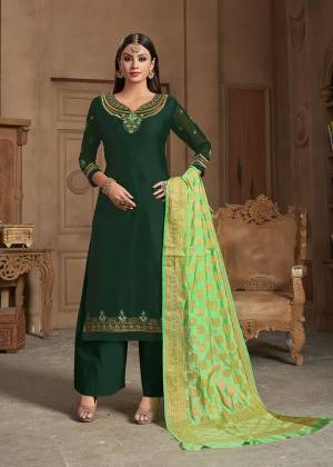 Celebrate This Festive Season Wearing This Designer Straight Suit In Dark Green Color Paired With Light Green Colored Dupatta. Its Top Is Fabricated On Satin Georgette Paired With Santoon Bottom And Banarasi Silk Dupatta. Buy This Suit Now.