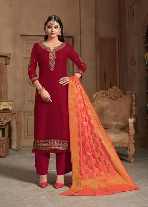 Adorn The Pretty Angelic Look Wearing This Designer Straight Suit In Red Color Paired With Contrasting Dark Peach Colored Dupatta. Its Embroidered Top Is Fabricated On Satin Georgette Paired With Santoon Bottom And Banarasi Silk Fabricated Dupatta.
