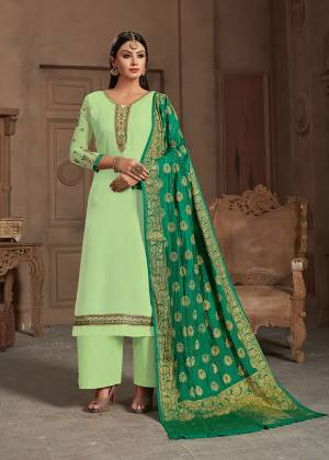 Summer Is All About Colors, Grab This Beautiful Designer Straight Suit In Pastel Green Color Paired With Green Colored Dupatta, Its Embroidered Top Is Fabricated On Satin Georgette Paired With Santoon Bottom And Banarasi Silk Dupatta.Buy This Suit Now.