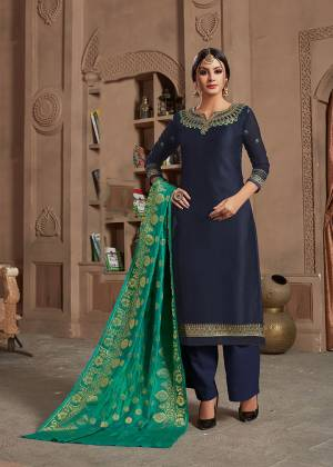 Enhance Your Personality In This Designer Navy Blue Colored Straight Suit Paired With Contrasting Sea Green Colored Dupatta. It Is Fabricated Satin Georgette Paired With Santoon Bottom And Banarasi Silk Dupatta. Its Top IS Beautified With Attractive Elegant Embroidery.